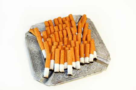 adverse: Pile of the cigarette butts in the ashtray Stock Photo