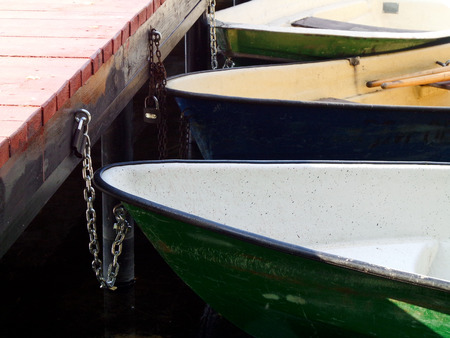 tether: The fastened boats at the berth