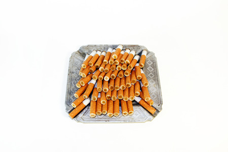 pernicious habit: Pile of the cigarette butts in the ashtray Stock Photo
