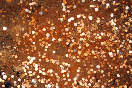 ferruginous: Coins on the bottom of the well