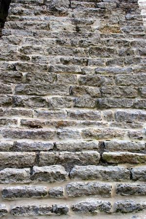uneven edge: stone wall