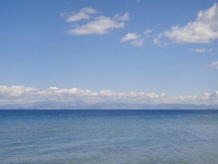 placid water: seascape and blue sky Stock Photo
