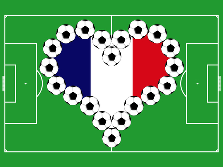 playing field: Soccer balls as the heart in colors of the flag of France on the background of the playing field Stock Photo