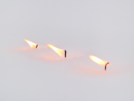 snowdrifts: The flames of the candles on the snow
