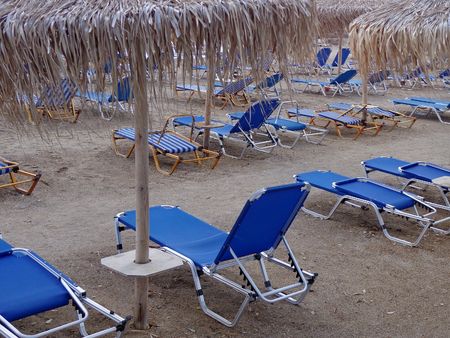 daybed: Sunbeds and umbrellas on the beach