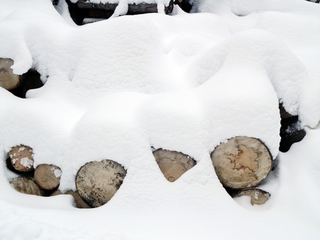 depot: Snow on the logs in the wood depot Stock Photo