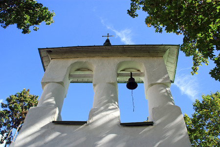 The bell in the bell tower of the church