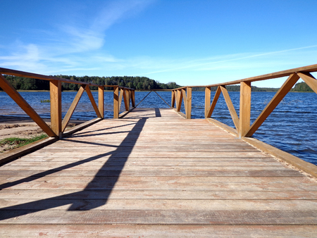 Wooden pier on the shore of the lake