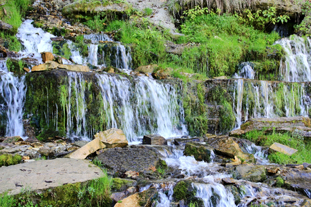Hillside and cascade of the waterfalls Stock Photo