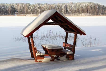 frozen lake: Pavilion on the shore of the frozen lake