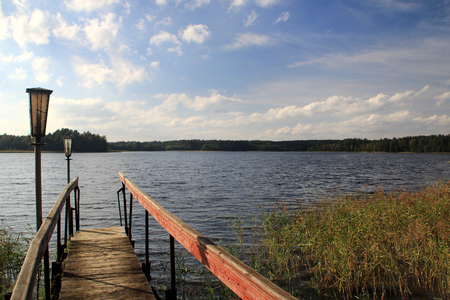 The wooden footbridge on the shore of the lake