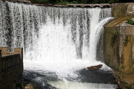 Water flow in the waterfall on the dam