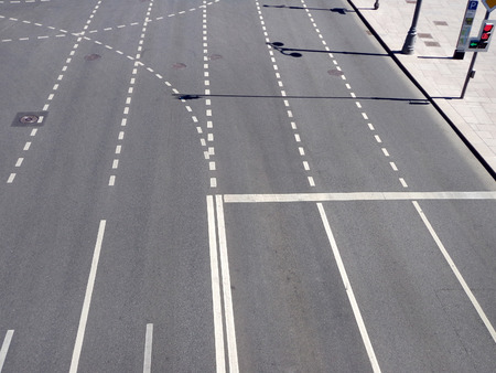 Road markings on an asphalt city street