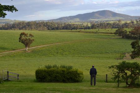 A priest looking at the farm in Tarrawara, Australia.