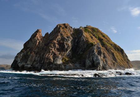 The crashing wave and rock. Around Komodo Island, Indonesia Stock Photo
