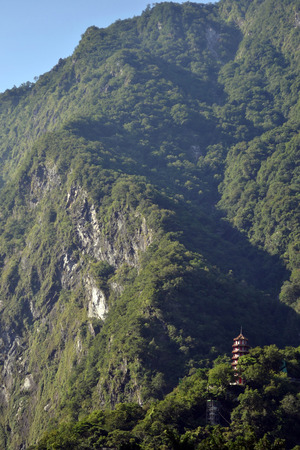 Hsiang-Te Temple in the middle of Taroko National Park in Taiwan. The town is called Tianxiang, and could be one best alternative (instead of Hua Lien, which is a bigger city) for those who want to sleep while surrounded by mountains. Stock Photo - 84314592
