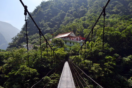 A wooden bridge connecting two gorges near Chan Guang Temple, Taroko National Park, Taiwan.