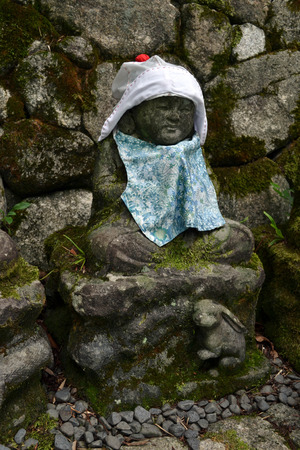 The statue of Baby Buddha wearing hat and cute clothes? While sittin on top of the Rabbit (Chinese zodiac sign). Pic was taken in Japan, August 2017.