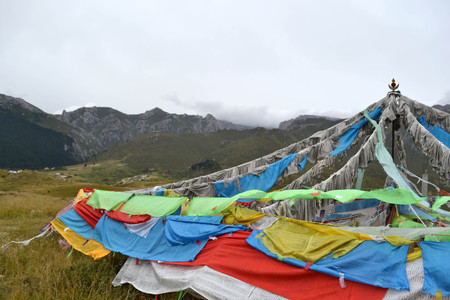 The prayer flags around the mountain behind Serti Gompa Monastery, in Langmusi - Amdo Tibet. Right next to it is the place to conduct sky burial ceremony. Pic was taken in September 2017. Stock Photo