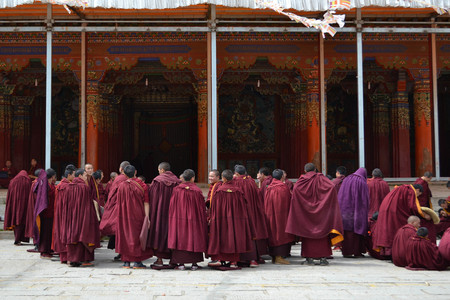 The life around Kirti Gompa Monastery in Langmusi, Amdo Tibet, China. Monks are everywhere, as this is the house of them. Even some of them are chanting mantras. Pic was taken in September 2017.