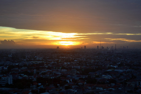 the golden sky during sunset in Jakarta. Pic was taken around one of West Jakartas suburb, in December 2015.