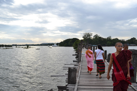 The peoples activity on U Bein bridge around Mandalay, Myanmar. Claimed to be the longest wooden bridge in the world and was the cover of Lonely Planets book. Pic was taken in August 2015