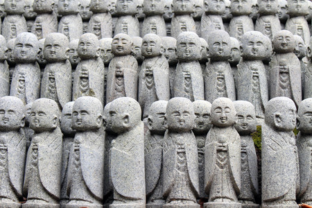 The statues of Buddha Jizo, that found in many temples in Japan. Taken at Hase-dera temple, Kanagawa - February 2018. Stock Photo