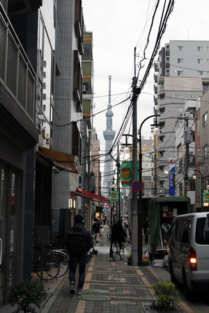 Tokyo Skytree between buildings during cloudy day, tallest structure in Japan. Often mistaken as Tokyo Tower. Taken in Tokyo, Japan - February 2018. Editorial
