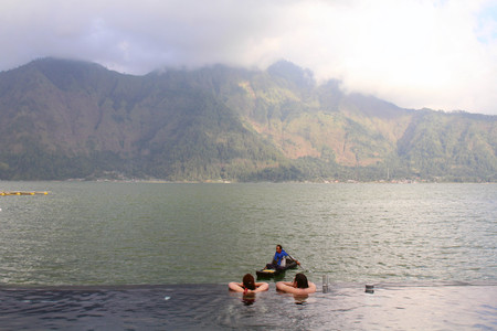 A hotspring in Bali (Toya Devasya), by the lake Batur, facing a mountain. What a view! Taken in May 2018.  Editorial
