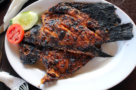 Grilled fish - Indonesian version. Or locally known as Ikan Bakar. Stock Photo