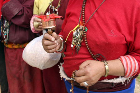 The mini Tibetan prayer wheel, used by a pilgrim. Deeply religious