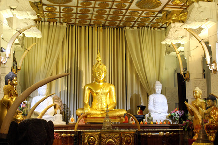 The statue of golden Buddha at Temple of the Sacred Tooth in Kandy. Taken in Sri Lanka, August 2018.