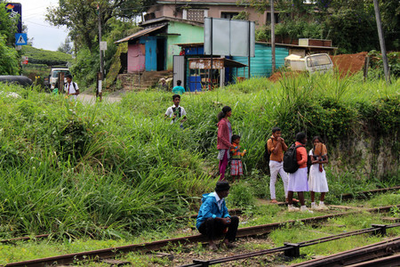 A group of local people waiting the train to pass, along the way to Ella. Taken in Sri Lanka, August 2018.