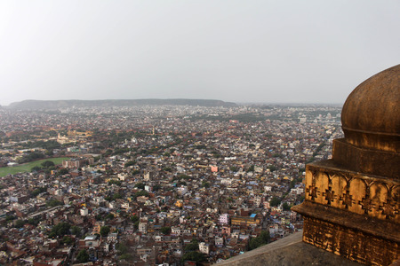 The stone railing and scenery of Jaipur city, seen from Nahargarh Fort on the hill. Taken in India, August 2018. Editorial