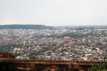The stone railing and scenery of Jaipur city, seen from Nahargarh Fort on the hill. Taken in India, August 2018. Sajtókép