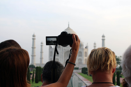 The tourists taking photos of Taj Mahal in a crowd. Taken in Agra, India, August 2018 Stock fotó