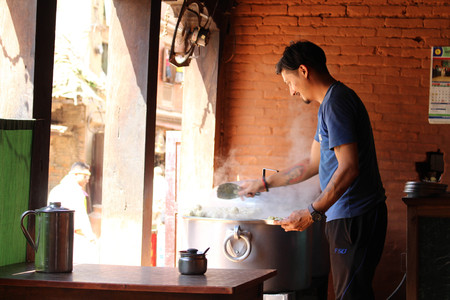 A man serving Momo at one shop, the South Asian or Tibetan dumpling. Taken in Bhaktapur Nepal, August 2018.