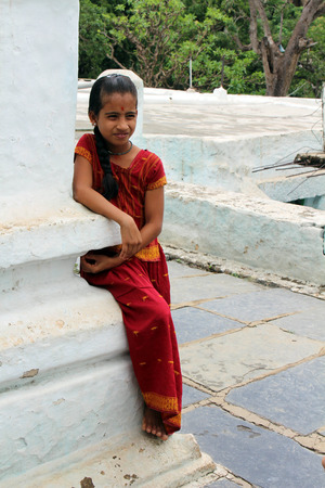 A little Indian girl with traditional clothes at one temple in Varanasi. Taken in India, August 2018.