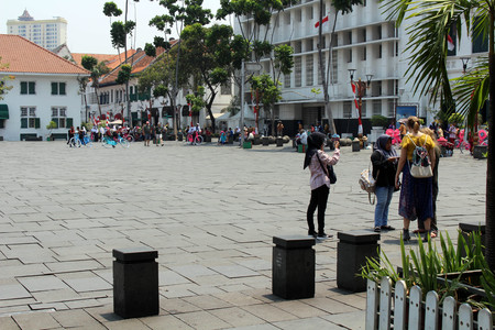 Indonesians asking foreign tourists for a survey or English education practice in Kota Tua Old Town. Taken in Jakarta, October 2018.