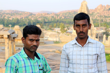 Indian adults did a pose as they asked to be taken a photo of. Taken in Hampi, India, July 2015.