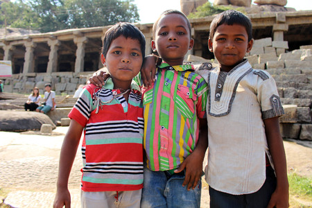 Indian kids did a pose as they asked to be taken a photo of. Taken in Hampi, India, July 2015.