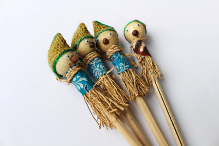 A traditional pencil with a scarecrow as decoration. Exotic.
