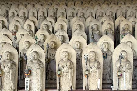 Line of hundreds of Buddha jizo statues at Reisenji Buddhist Temple. Taken in Beppu, Oita, Japan, April 2019.