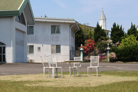 Empty chairs and Church of Monastery of Our Lady of the Annunciation in Japan. Taken in Oita, April 2018.