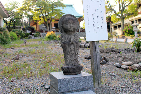 Baby Buddha statue or Jizo at Reisenji Japanese Buddhist Temple. Taken in Beppu, Oita, April 2019