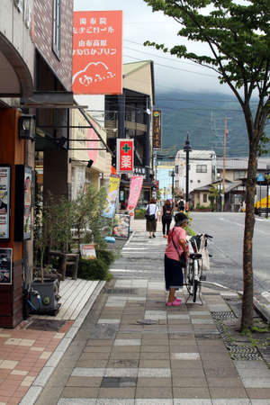 Locals and tourists walking around Yufuin town, an onsen destination. Taken in June 2019. Stock Photo