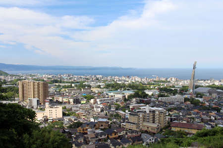 The panoramic view of Beppu City, its Tower, and the cruise in the sea in Oita Prefecture, Japan. Taken in April 2019. Redakční