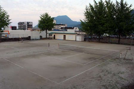 Tennis court with sand surface in Beppu, Japan. Taken in June 2019.