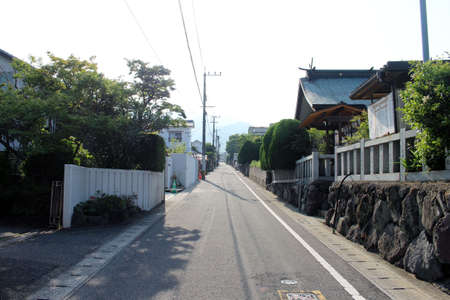 Japanese street, a temple by the roadside around the residential area in Beppu, Japan. Taken in June 2019.