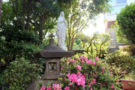 Statue of Virgin Mary with a Japanese toro, in a Salesian Nunnery. Taken in Beppu, Japan. June 2019. Redakční